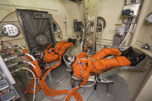 Member of the Johnson Space Center team participate in Vacuum Pressure Integrated Suit testing of the spacesuit astronauts will wear during Orion spacecraft missions into deep space in this March 17, 2015 handout photo at the Johnson Space Center in Houston, Texas provided by NASA March 19, 2015 . Astronauts will board the Orion spacecraft for the first crewed flight in 2021 according to NASA. REUTERS/Bill Stafford/NASA ATTENTION EDITORS - FOR EDITORIAL USE ONLY. NOT FOR SALE FOR MARKETING OR ADVERTISING CAMPAIGNS. THIS PICTURE WAS PROVIDED BY A THIRD PARTY. REUTERS IS UNABLE TO INDEPENDENTLY VERIFY THE AUTHENTICITY, CONTENT, LOCATION OR DATE OF THIS IMAGE. THIS PICTURE IS DISTRIBUTED EXACTLY AS RECEIVED BY REUTERS, AS A SERVICE TO CLIENTS - TM3EB3J0TUM01