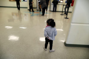 "A girl waits with visitors in the lobby of the Adelanto immigration detention center, which is run by the Geo Group Inc (GEO.N), in Adelanto, California, U.S., April 13, 2017. REUTERS/Lucy Nicholson SEARCH ""ICE NICHOLSON"" FOR THIS STORY. SEARCH ""WIDER IMAGE"" FOR ALL STORIES. - RC1D545F60C0"