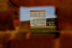 A prototype for President Donald Trump's border wall with Mexico is seen behind the current border fence in this picture taken from the Mexican side of the border in Tijuana, Mexico. Photo by Jorge Duenes/Reuters