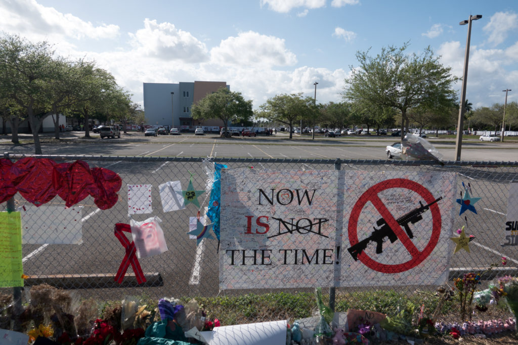 Messages, posted on a fence, hang, as students and parents attend a voluntary campus orientation at the Marjory Stoneman Douglas High School, before its reopening. REUTERS/Angel Valentin