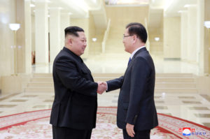 North Korean leader Kim Jong Un shakes hands with Chung Eui-yong who is leading a special delegation of South Korea's President, in this photo released by North Korea's Korean Central News Agency (KCNA). Photo by KCNA via Reuters