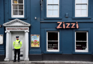 A police officer stands outside a restaurant which was closed after former Russian inteligence officer Sergei Skripal, and a woman were found unconscious on a bench nearby after they had been exposed to an unknown substance, in Salisbury, Britain, March 6, 2018. REUTERS/Toby Melville - RC1842E806C0