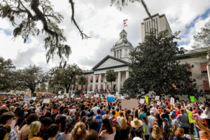 FILE PHOTO: Protestors rally outside the Capitol urging Florida lawmakers to reform gun laws, in the wake of last week's mass shooting at Marjory Stoneman Douglas High School, in Tallahassee, Florida, U.S., February 21, 2018. REUTERS/Colin Hackley/File Photo - RC1B51DC11F0