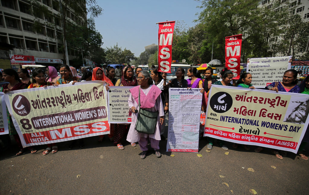 Demonstrators hold banners during a protest demanding equal rights for women on the occasion of International Women's Day, in Ahmedabad, India. Photo by Amit Dave/Reuters