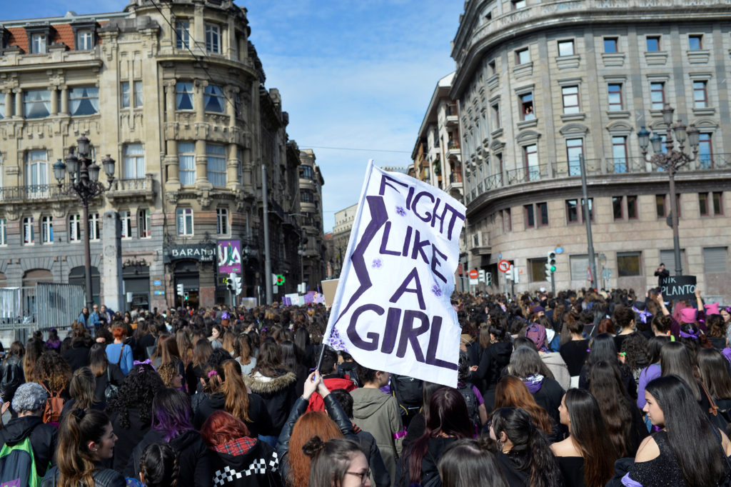 "A protester holds a banner reading ""Fight Like A Girl"" during a demonstration for women's rights on International Women's Day in Bilbao, Spain. Photo by Vincent West/Reuters"
