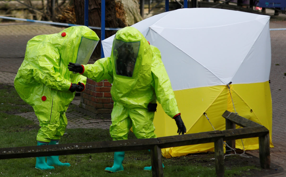 The forensic tent, covering the bench where Sergei Skripal and his daughter Yulia were found, is repositioned by officials in protective suits in the centre of Salisbury, Britain. Photo by Peter Nicholls/Reuters