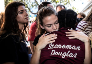 Students from Marjory Stoneman Douglas High School attend a memorial following a school shooting in Parkland, Florida, on Feb. 15. File photo by Thom Baur/Reuters