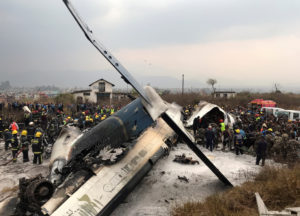 Wreckage of an airplane is pictured as rescue workers operate at Kathmandu airport, Nepal. Photo by Navesh Chitrakar/Reuters