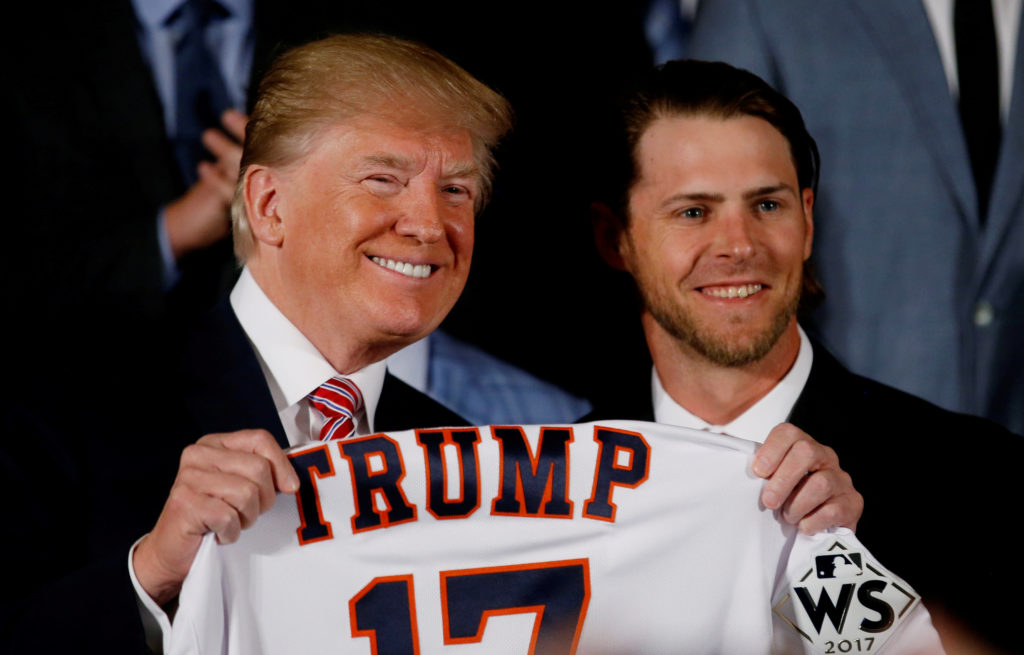 President Donald Trump poses for a portrait with Josh Reddick of the Houston Astros, and the rest of the 2017 World Series Champions after having been gifted a custom jersey in the East Room at the White House in Washington, D.C. Photo by Leah Millis/Reuters