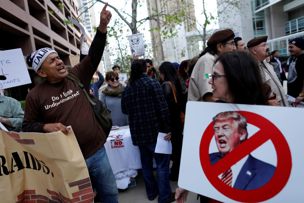 Activists and community groups hold a rally to condemn the visit of President Donald Trump to California ahead of his visit to view border wall prototypes in San Diego, California. Photo by Mike Blake/Reuters