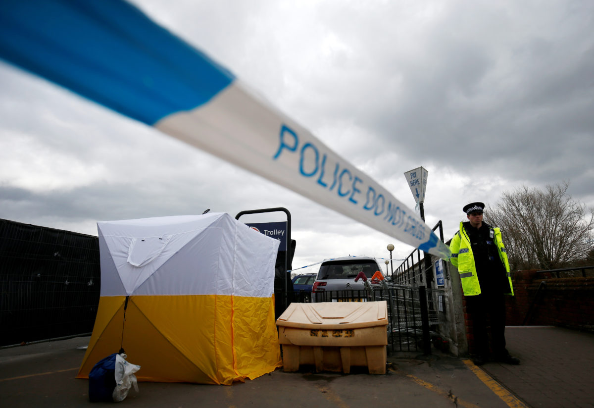A police officer stands at a cordon placed around a payment machine covered by a tent in a supermarket car park near to where former Russian intelligence agent Sergei Skripal and his daughter Yulia were found poisoned in Salisbury, Britain. Photo by Henry Nicholls/Reuters