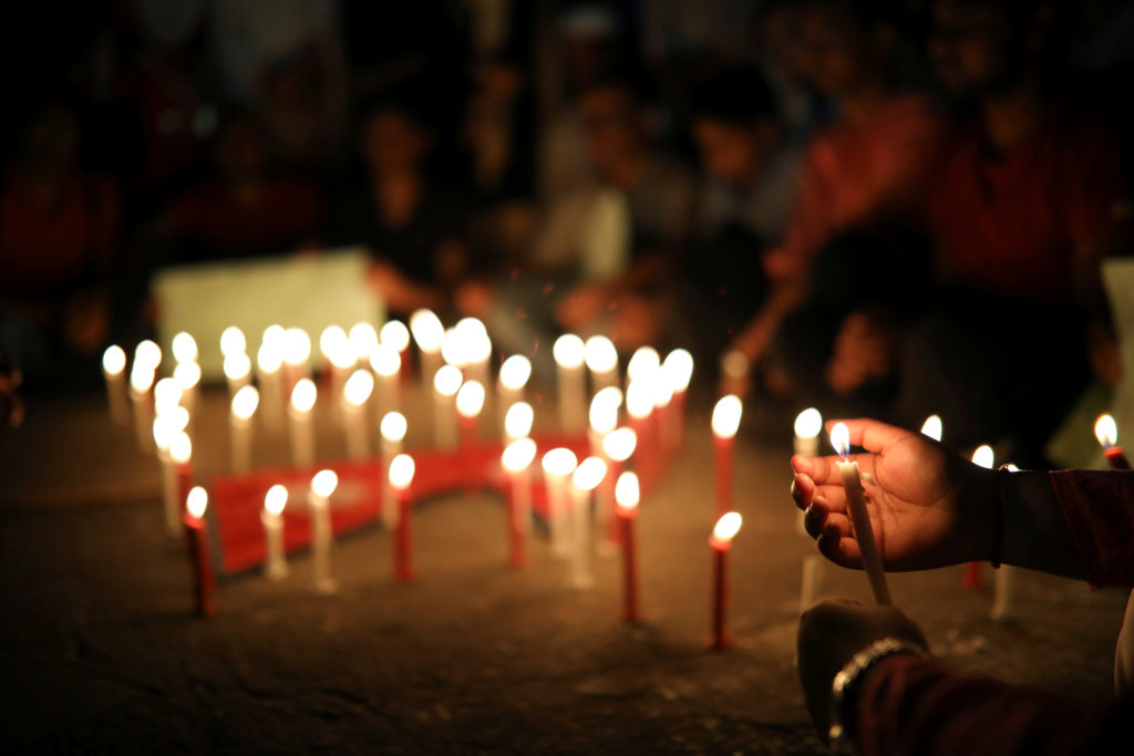 Nepali students of University of Dhaka light candles in memory of the victims of the US-Bangla aircraft crash in Nepal, in Dhaka, Bangladesh. Photo by Mohammad Ponir Hossain/Reuters