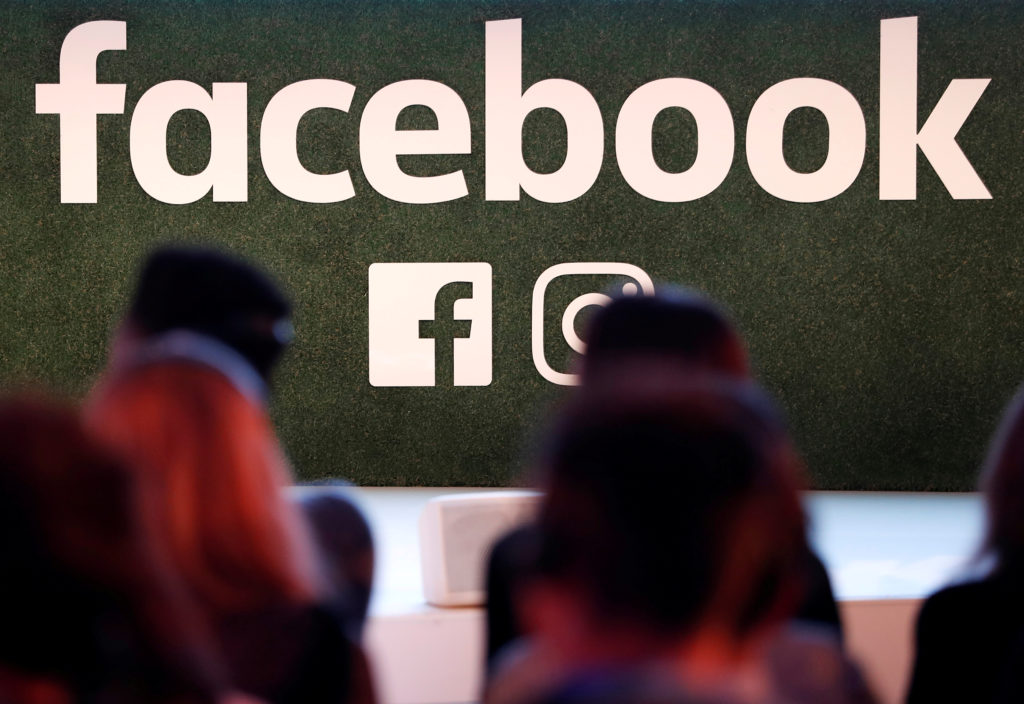 FILE PHOTO: A Facebook logo is seen at the Facebook Gather conference in Brussels, Belgium January 23, 2018. REUTERS/Yves ...