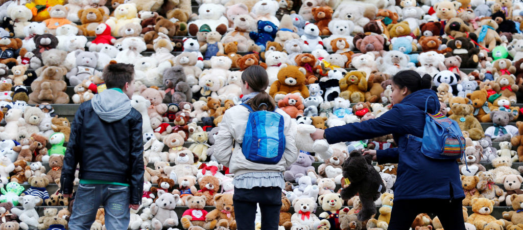 Students in Berlin collected 740 teddy bears in front of the concert hall Konzerthaus during an event of the World Vision Organisation to raise awareness about 740,000 Syrian refugee children who can't attend school in their current situation. Photo by Hannibal Hanschke/Reuters