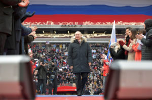 Russian President Vladimir Putin arrives to take part in a March rally to support his bid in the upcoming presidential election, at Luzhniki Stadium in Moscow, Russia. Photo by Sputnik/Alexei Druzhinin/Kremlin via Reuters