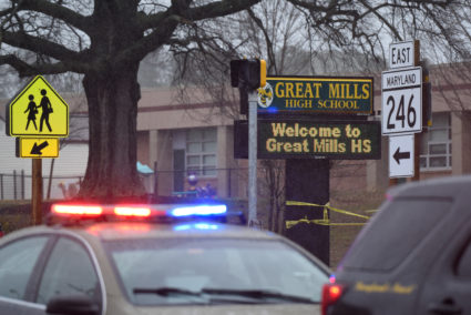 Law enforcement vehicles are seen outside the Great Mills High School following a March 20 shooting in St. Mary's County, Maryland. Photo by Sait Serkan Gurbuz/Reuters