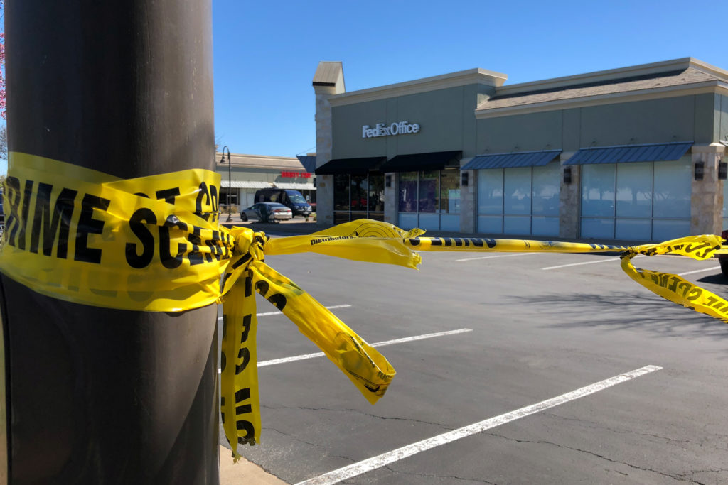 A police crime scene tape blocks off a FedEx store which is closed, with police saying it may be linked to the overnight bomb at Schertz, Texas FedEx facility, in Austin, Texas, U.S., March 20, 2018. REUTERS/Jon Herskovitz