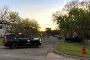 A Texas Department of Public Safety vehicle blocks a street into the neighborhood where the Austin bomb suspect may lived in Pfluggerville, Texas. Photo by Jon Herskovitz/Reuters