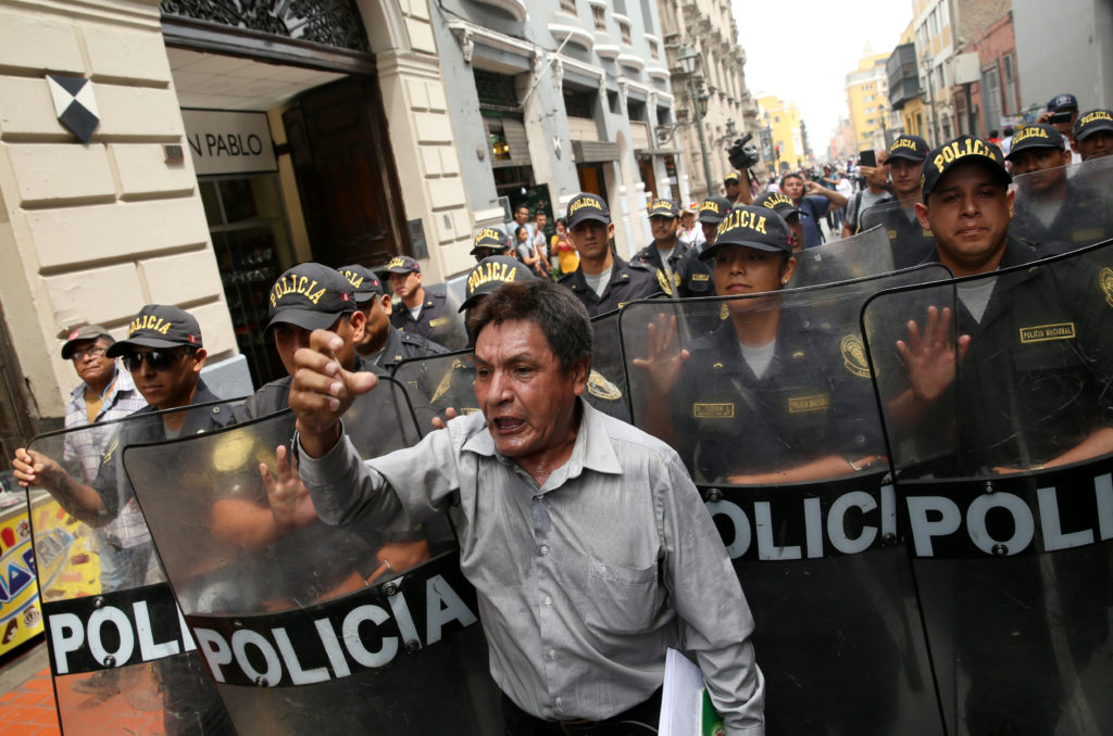 People protest against Peruvian President Pedro Pablo Kuczynski's government in Lima on March 21. Photo by Guadalupe Pardo/Reuters