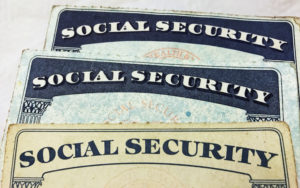 U.S. Social Security card designs over the past several decades. Photo by REUTERS/Hyungwon Kang