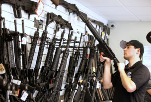 "Salesman Ryan Martinez clears the chamber of an AR-15 at the ""Ready Gunner"" gun store In Provo, Utah, U.S. in Provo, Utah, U.S., June 21, 2016. Photo by George Frey/Reuters"