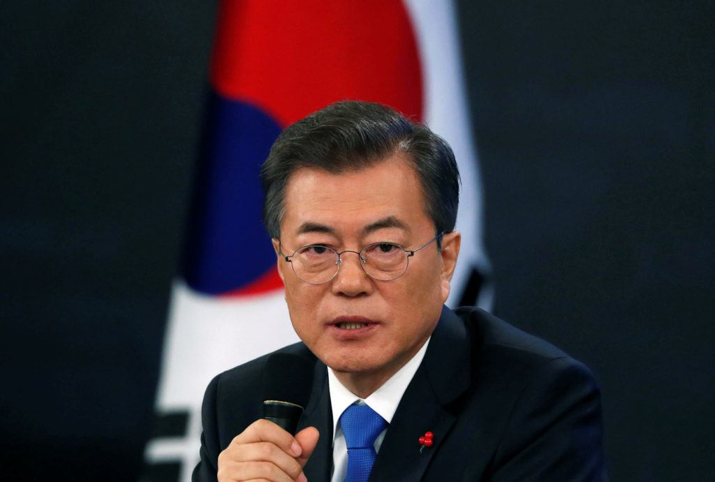 South Korean President Moon Jae-in answers reporters' question during his New Year news conference at the Presidential Blue House in Seoul, South Korea. Photo by Kim Hong-Ji/Reuters