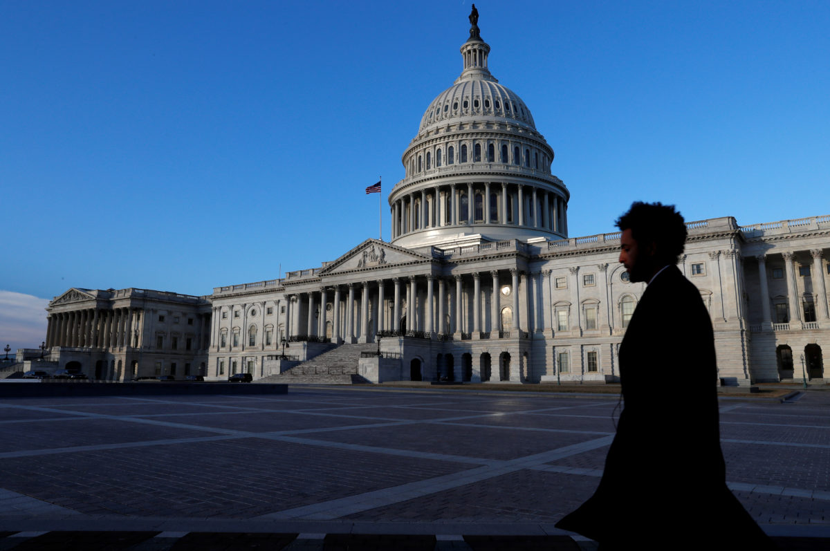 People walk by the Capitol building in Washington, D.C. Photo by Leah Millis/Reuters