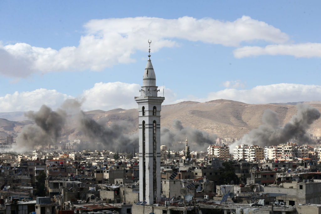 Smoke rises from the besieged Eastern Ghouta in Damascus, Syria. Ph…