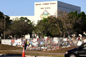 A memorial seen outside of Marjory Stoneman Douglas High School as students arrive for the first time since the mass shooting in Parkland, Florida, U.S., February 28, 2018. Photo by Mary Beth Koeth/Reuters