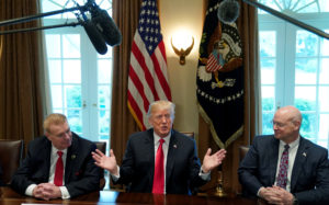 Chairman, CEO and President of Nucor John Ferriola and U.S. Steel CEO Dave Burritt flank U.S. President Donald Trump as he announces that the United States will impose tariffs of 25 percent on steel imports and 10 percent on imported aluminum during a meeting at the White House in Washington, U.S., March 1, 2018. REUTERS/Kevin Lamarque - RC1A1B5AE7E0