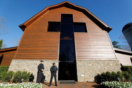 Police officers stand guard in front of the Billy Graham Library before the start of the funeral for evangelist Billy Graham in Charlotte, North Carolina, U.S., March 2, 2018. REUTERS/Jonathan Drake - RC1F4B9B5DF0