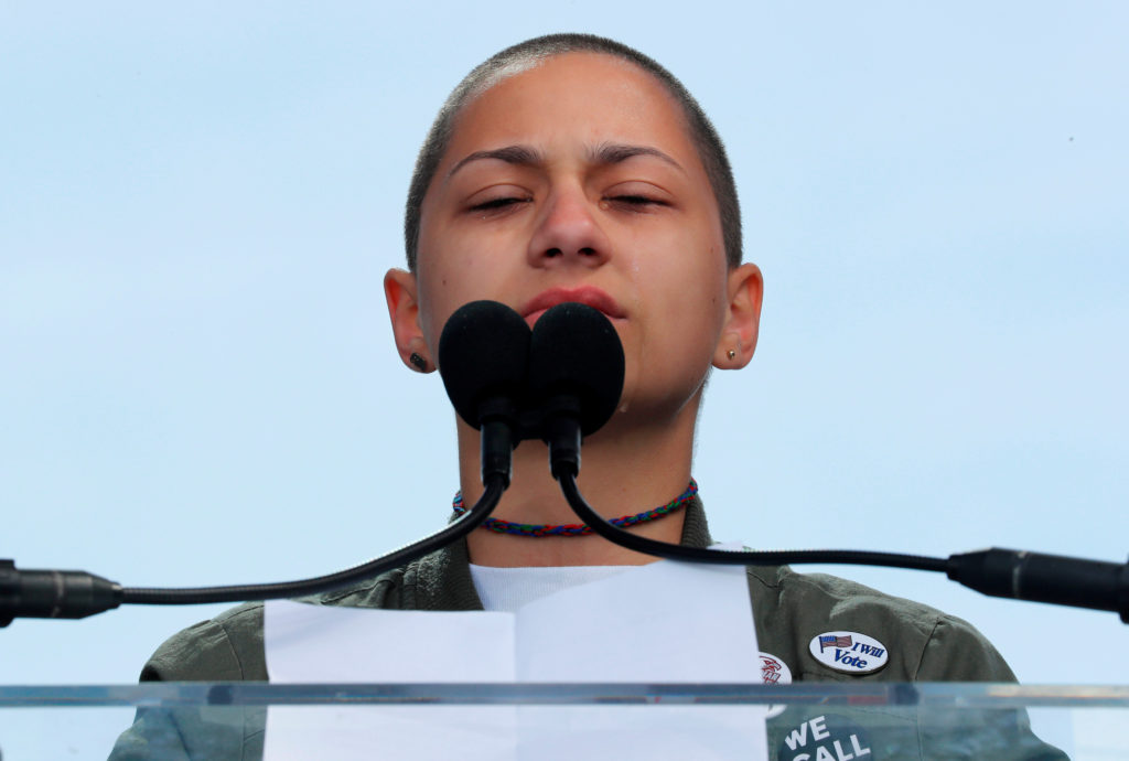 """Emma Gonzalez, a student and shooting survivor from the Marjory Stoneman Douglas High School in Parkland, Florida, cries as she addresses the conclusion of the """"March for Our Lives"""" event demanding gun control after recent school shootings at a rally in Washington, U.S., March 24, 2018. REUTERS/Jonathan Ernst"""