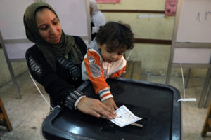 A woman casts her vote in Monday's presidential election in Cairo, Egypt. Photo by Ammar Awad/Reuters