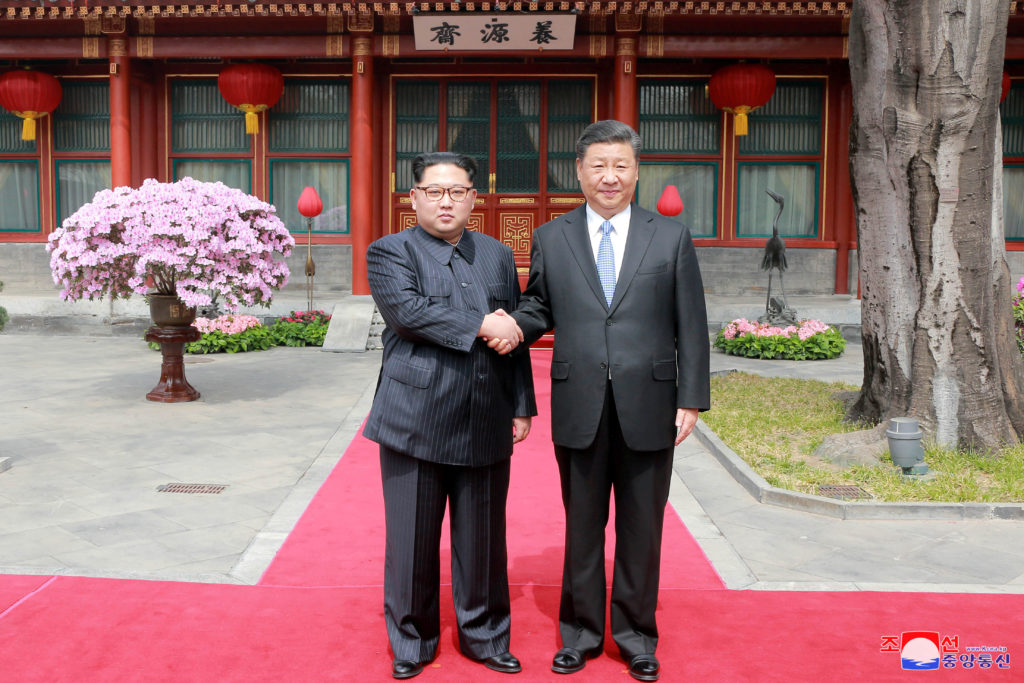 North Korean leader Kim Jong Un shakes hands with Chinese President Xi Jinping in Beijing, as he paid an unofficial visit to China, in this undated photo released by North Korea's Korean Central News Agency (KCNA) in Pyongyang. Photo by KCNA via Reuters