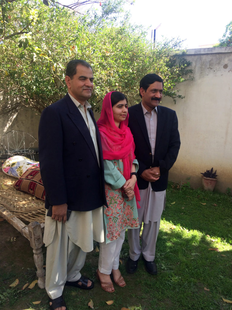 Nobel Peace Prize laureate Malala Yousafzai (C) stands with her father and a friend of him while visiting her hometown Mingora in Swat Valley, Pakistan March 31, 2018. Photo by Reuters