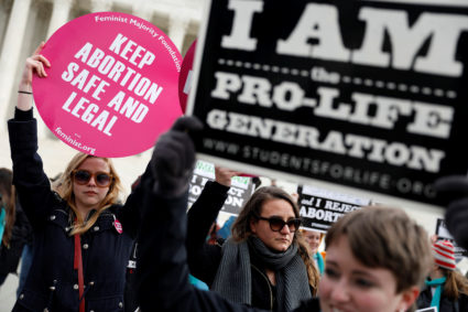 Pro-life and pro-choice activists gather at the Supreme Court for the National March for Life rally in Washington January 27, 2017. REUTERS/Aaron P. Bernstein - RC18896B8B20