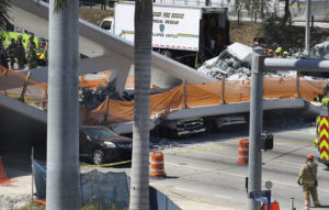 MIAMI, FL - MARCH 15: Vehicles are seen trapped under the collapsed pedestrian bridge that was newly built over southwest 8th street allowing people to bypass the busy street to reach Florida International University on March 15, 2018 in Miami, Florida. Reports indicate that there are an unknown number of fatalities as a result of the collapse, which crushed at least five cars. (Photo by Joe Raedle/Getty Images)