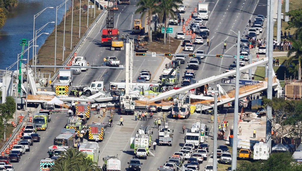 Aerial view shows a pedestrian bridge collapsed at Florida International University in Miami, Florida, U.S., March 15, 2018. REUTERS/Joe Skipper - RC14422201E0