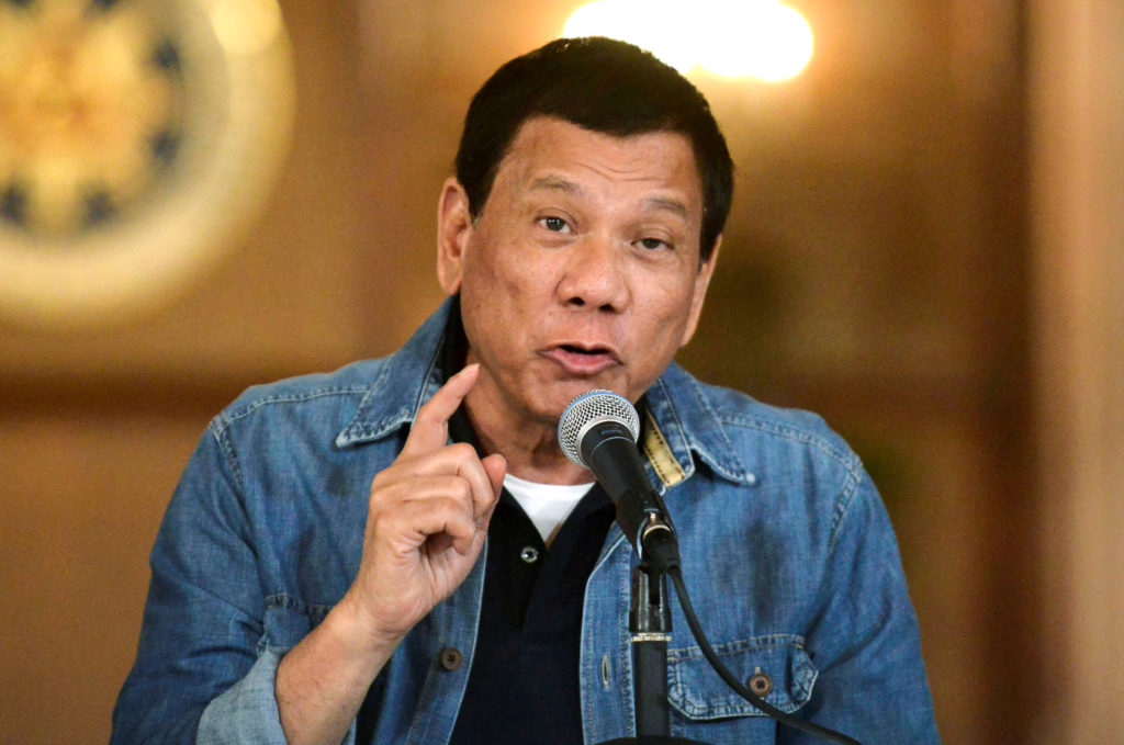 FILE PHOTO: Philippine President Rodrigo Duterte announces the disbandment of police operations against illegal drugs at the Malacanang palace in Manila, Philippines early January 30, 2017.     REUTERS/Ezra Acayan/File Photo - RC12DD32F6B0