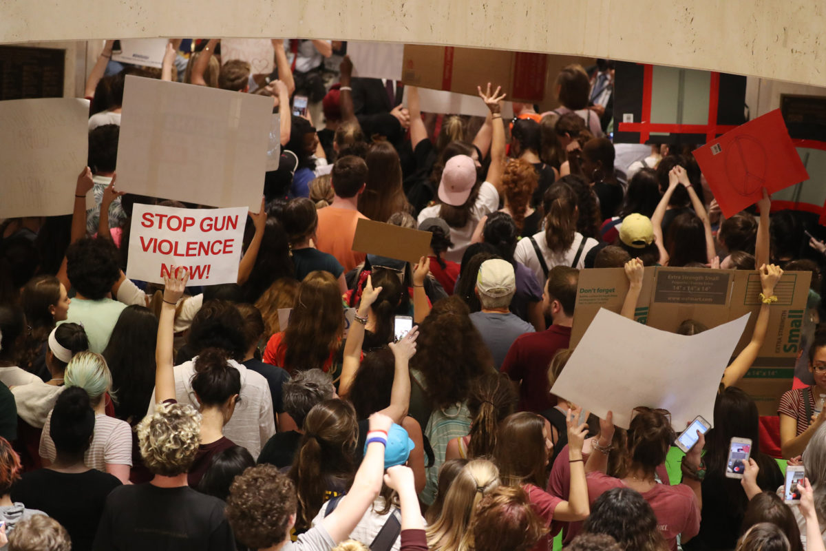 """After no luck at the governor's office, students storm the Florida House of Representatives chambers in Tallahassee, Fla. chanting """"vote them out"""" and """"we're students united, we'll never be divided"""" on Wednesday, Feb. 21, 2018. (Susan Stocker/Sun Sentinel/TNS via Getty Images)"""
