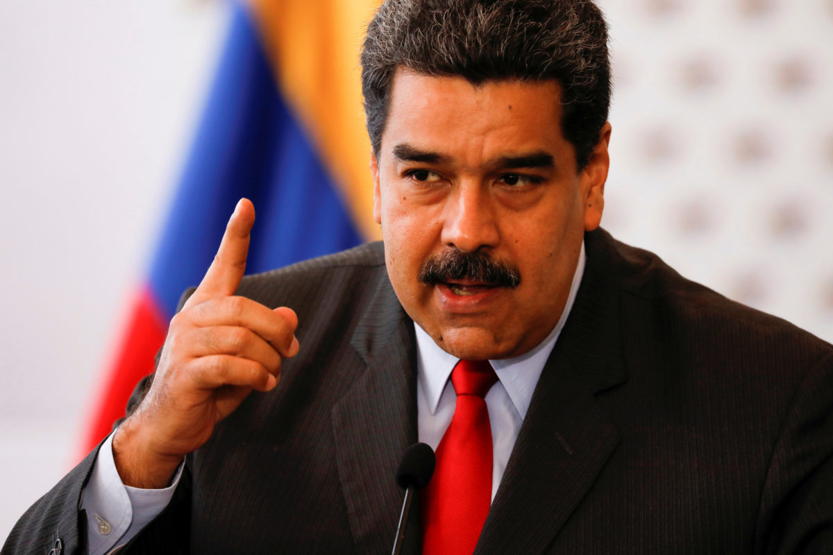 FILE PHOTO: Venezuela's President Nicolas Maduro talks to the media after a meeting for signing an agreement on guarantees for the vote at the National Electoral Council (CNE) headquarters in Caracas, Venezuela March 2, 2018. REUTERS/Marco Bello/File Photo - RC1BB33DA760