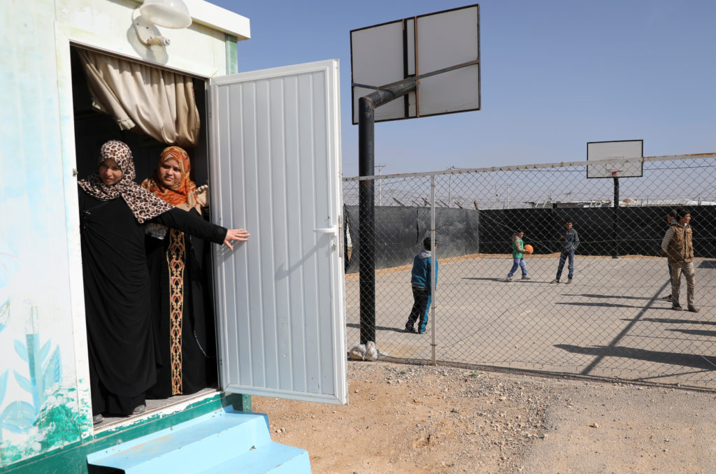 Syrian refugees peep out from a door in Al Zaatari refugee camp during United Nations Secretary General Antonio Guterres' visit to the camp near Mafraq, Jordan near the border with Syria March 28, 2017. REUTERS/Ammar Awad