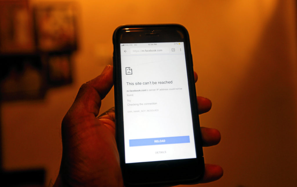 A mobile phone  screen shows that Face Book page can not open after government decided to shut down social messaging networks including Facebook islandwide  in Colombo, Sri Lanka March 7, 2018. REUTERS/Dinuka Liyanawatte - RC18015CED80