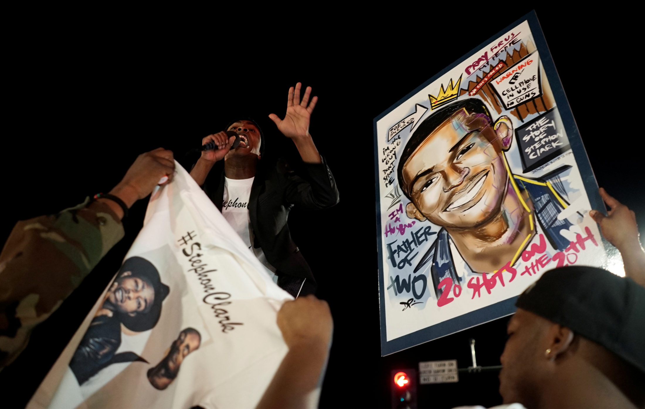 Stevante Clark, brother of Stephon Clark, speaks to the crowd during a vigil to protest the police shooting of Stephon Clark, in Sacramento, California. Photo by Bob Strong/Reuters