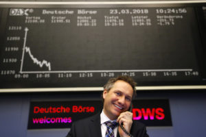 A shares trader reacts at the stock exchange in Frankfurt, Germany, March 23, 2018. Photo by Kai Pfaffenbach/REUTERS