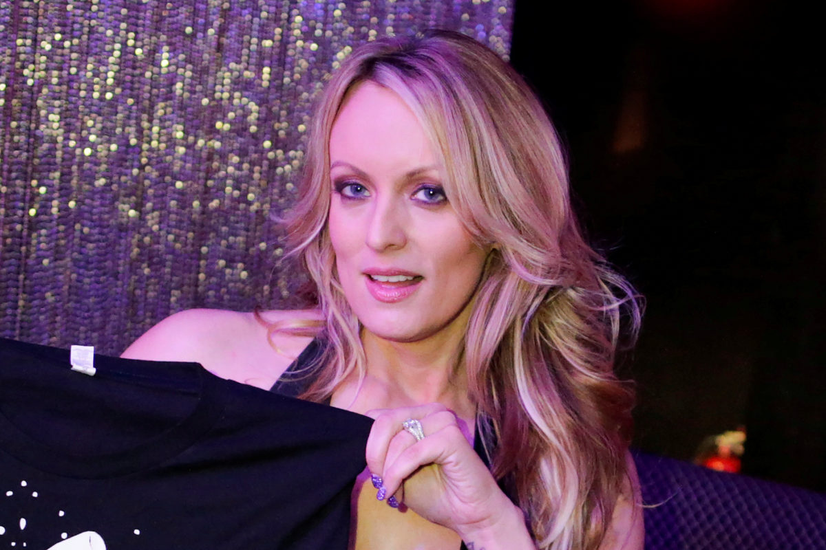 FILE PHOTO: Adult-film actress Stephanie Clifford, also known as Stormy Daniels, poses for pictures at the end of her striptease show in Gossip Gentleman club in Long Island, New York, U.S., February 23, 2018. REUTERS/Eduardo Munoz/File photo - RC1F40296810