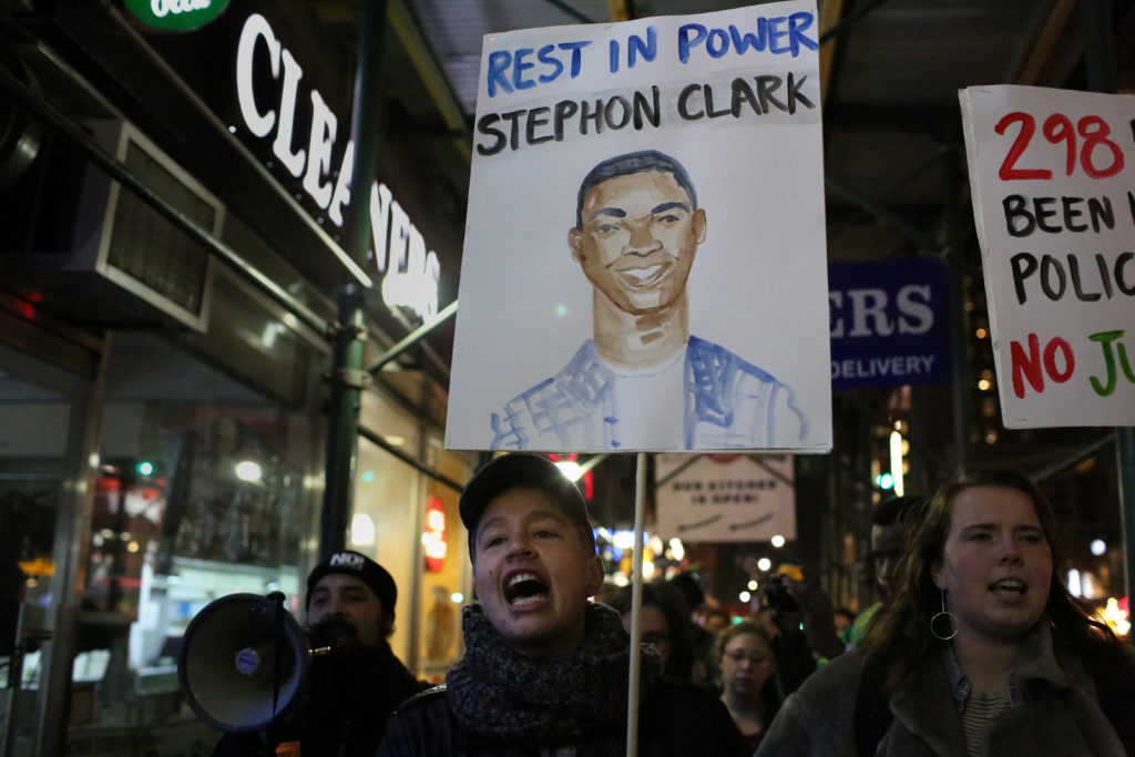 Protesters chant slogans as they march in Times Square in the Manha…