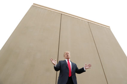 U.S. President Donald Trump speaks while participating in a tour of U.S.-Mexico border wall prototypes near the Otay Mesa Port of Entry in San Diego, California. U.S., March 13, 2018. REUTERS/Kevin Lamarque - HP1EE3D1J8Y5A