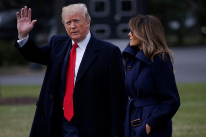 U.S. President Donald Trump waves to the news media while walking with first lady Melania Trump to board Marine One to depart for travel to New Hampshire from the South Lawn of the White House in Washington, U.S., March 19, 2018. REUTERS/Leah Millis - RC1A7071EBB0