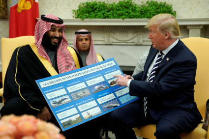 U.S. President Donald Trump holds a chart of military hardware sales as he welcomes Saudi Arabia's Crown Prince Mohammed bin Salman in the Oval Office at the White House in Washington, U.S., March 20, 2018. REUTERS/Jonathan Ernst - RC1D275A0090